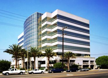 5805 Sepulveda Blvd. in Sherman Oaks, counts Caine & Weiner, which will now be headquartered in the 8-story building, among its tenants. Photo: Commercial Asset Group