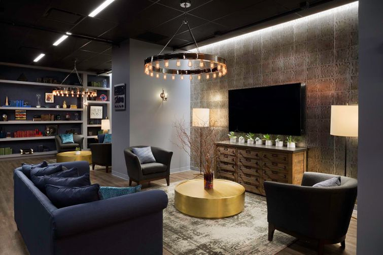 The lounge in the basement for parties features relaxing furniture and finishes.