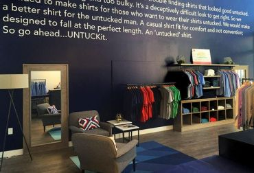 Inside the Soho store of Untuckit. While each store is tailored to its location, they all have a wall outlining the Untuckit story.
