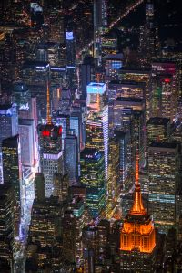 "The Empire State Building, 4 Times Square and 1 Bryant Park lit up ""Amazon Orange."" Image: New York City Economic Development Corporation"
