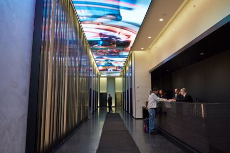 ESRT's new ceiling screen at 250 West 57th Street is the main feature of the new Gensler-designed lobby.