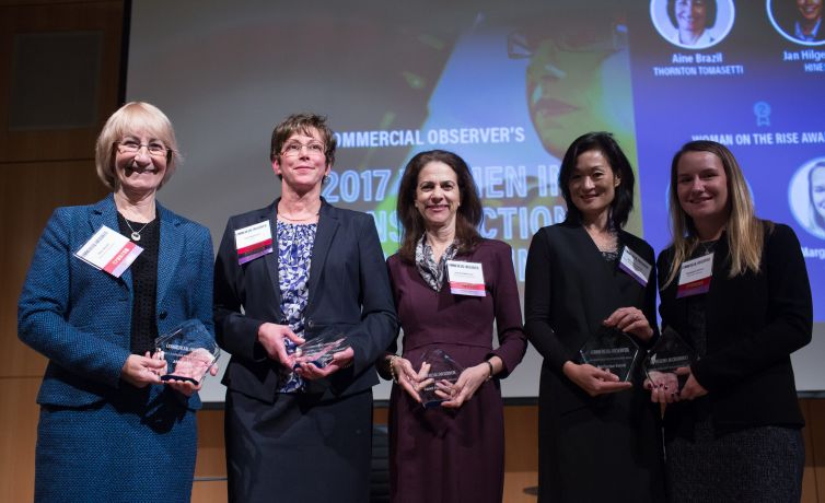 """(From left) Aine Brazil, Jan Hilgeman, Carol Patterson, Marianne Kwok and Margaret Wrzos hold their 2017 """"Women in Construction"""" awards."""
