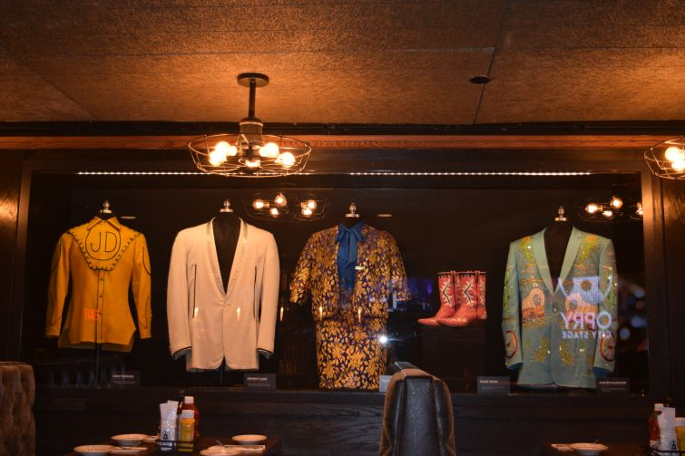 Some of the memorabilia encased in glass, including Johnny Cash's white suit.