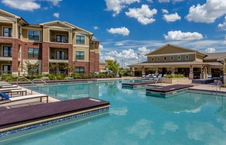 The swimming pool and two buildings at the Parkside Place development near Houston.