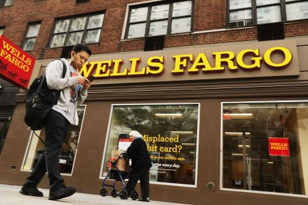 People walk by a Wells Fargo bank branch in New York City.
