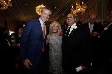 Mayor Bill de Blasio, C&W's Joanne Podell and REBNY President John Banks.