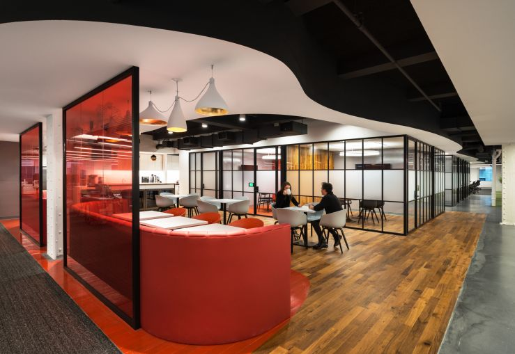 Red is AlphaSights signature color, and the only color used in the offices (save for the wood) that isn't a neutral hue such as black, white or gray.