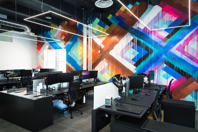 Meadows Office Interiors new location at 625 West 55th Street features open work stations and an art wall.