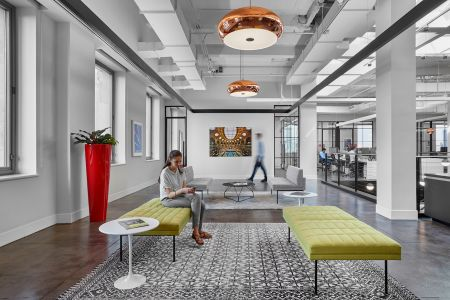 Artwork and copper lights help define the office.