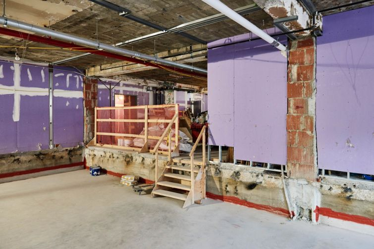 This raw space on the second floor, which used to be the MTA's money counting floor, will become four production studio rooms. Since the building has 10-foot ceiling heights, NYU dropped the floors four feet and borrowed height from the 20-foot ceiling heights in the ground floor to accommodate the studios.