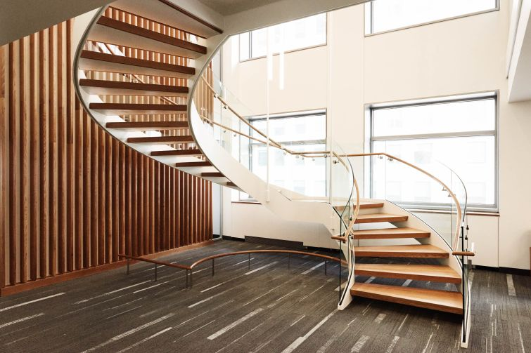 A spiral staircase made from wood is just one ways the university incorporated the sustainable material throughout the building.