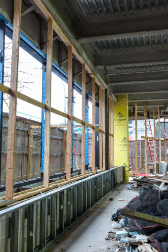 The ground floor space of the development will have a floor-to-ceiling glass corner, which will be occupied by CVS.
