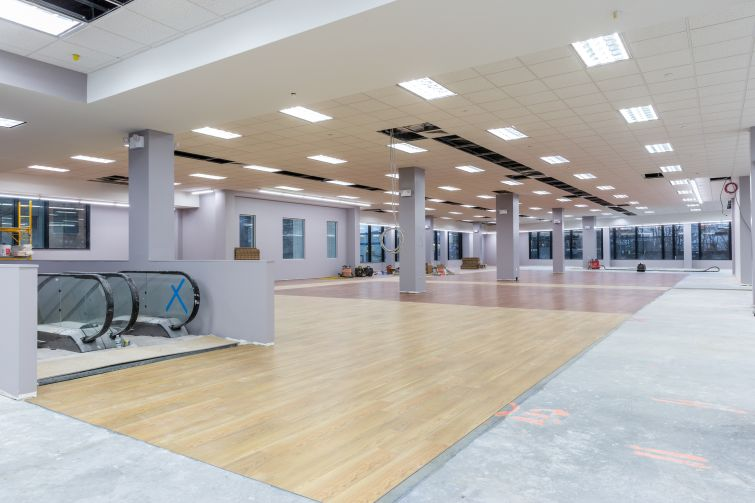 Modell's has already began building out its space with wooden floors.