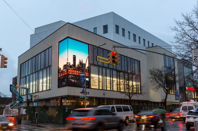 The exterior of 1601 Kings Highway in Sheepshead Bay features a two-sided video screen.