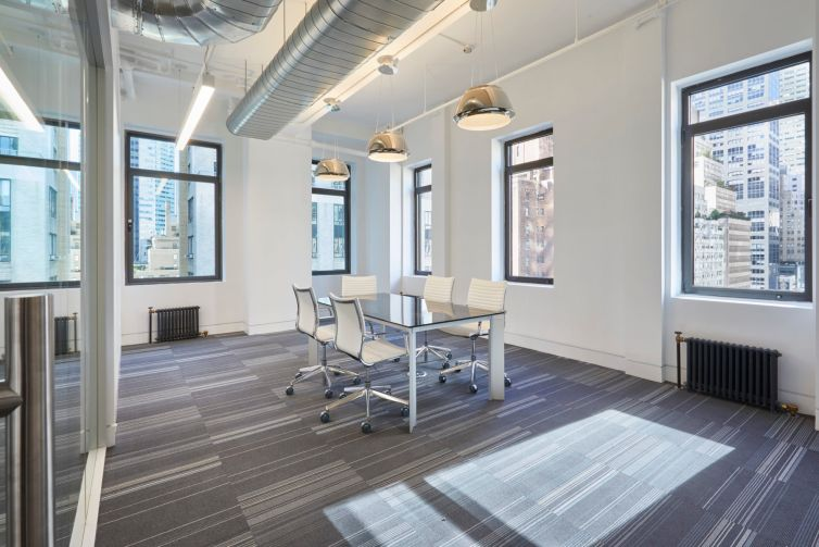 ABS placed carpeting in meeting rooms in the prebuilt offices.