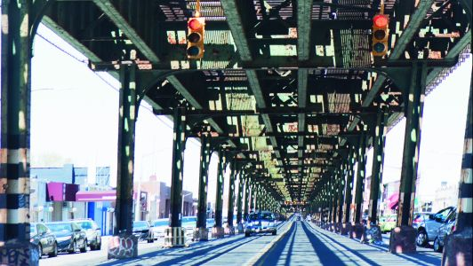 Jerome Avenue beneath the elevated 4 tracks in the Bronx.