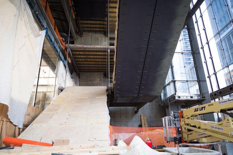 Escalators on the lobby led to the transportation hub underground.