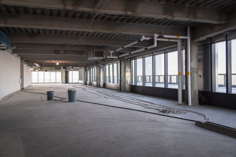 Floors are column free and have 13.5-foot ceiling heights.