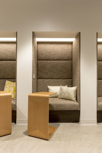 The fabric paneled walls inside the small work booths offer coworking members quiet privacy.