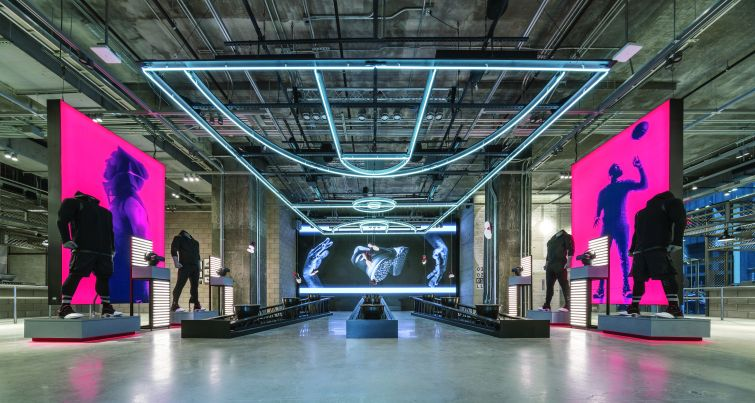 Gensler designed Adidas' retail flagship at 565 Fifth Avenue to resemble a football stadium.