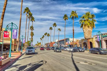 Palm trees line the city streets of the city of Palm Springs, California.