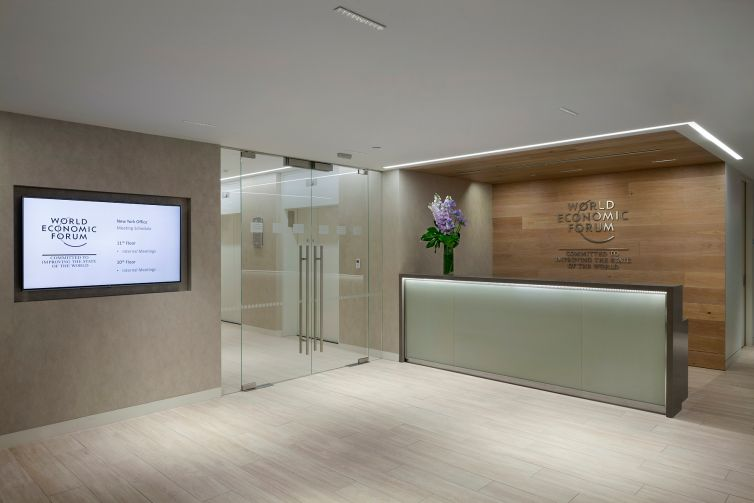 The reception desk has a glass front panel.