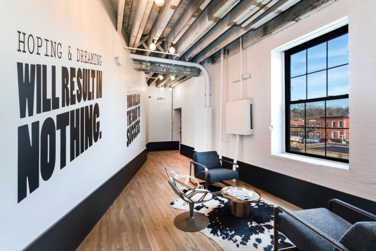 Office spaces in The Briq Building feature wood floors.