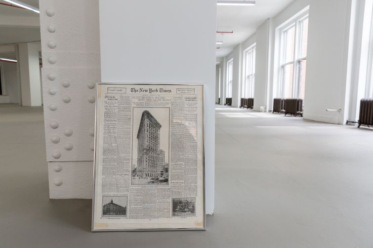 A historic newspaper clipping from 1911 announcing the building of 5 Columbus Circle.