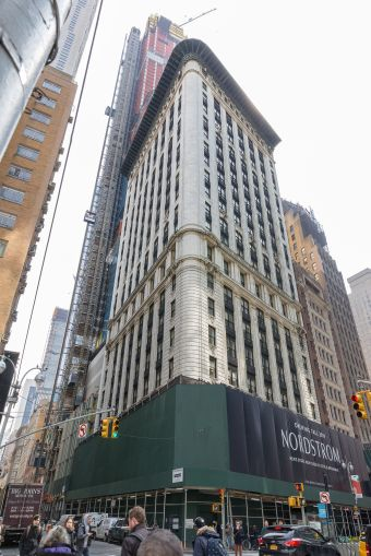 The bullnose facade of 5 Columbus Circle is undergoing renovation.