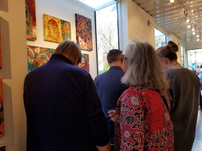 Guests gather around photos inside of Studio A. Photo: Christina Sturdivant Sani