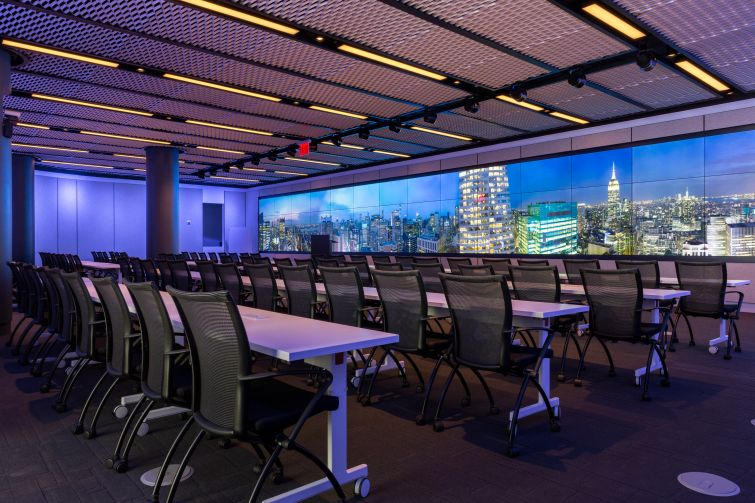The largest conference room on the Convene/Well & amenity floor at 4 Times Square features a gigantic customizable video screen, and seating for nearly 100.