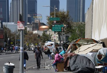 Los Angeles financial district skyscrapers are seen behind a homeless tent encampment in downtown Los Angeles.