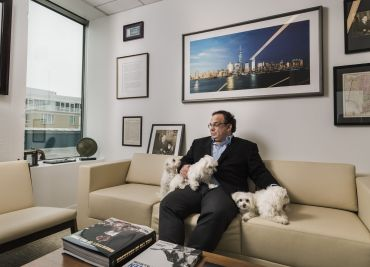 Michael DeMarco (and his four teacup Maltese dogs) in his office at Mack-Cali's Jersey City headquarters.