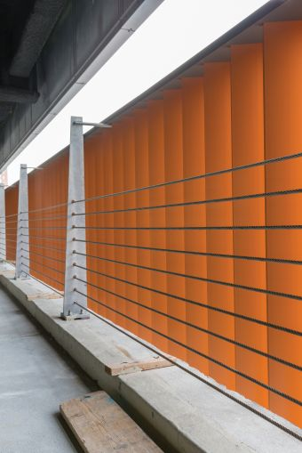 The brick colored aluminum panels on the second floor parking garage of 626 Sheepshead Bay Road not only hide cars from public view, but their color mimics the look and feel of other brick buildings in the neighborhood.