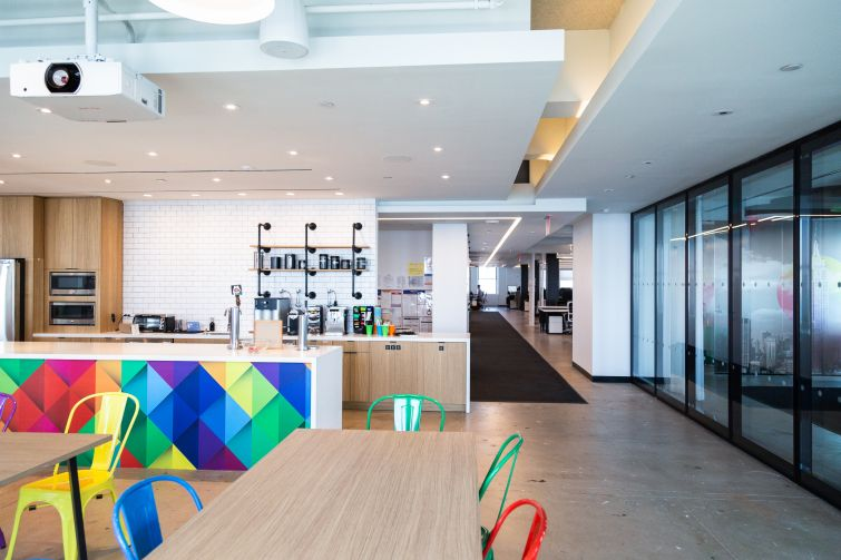 Agoda's offices have a massive pantry with colorful chairs and beer on tap.