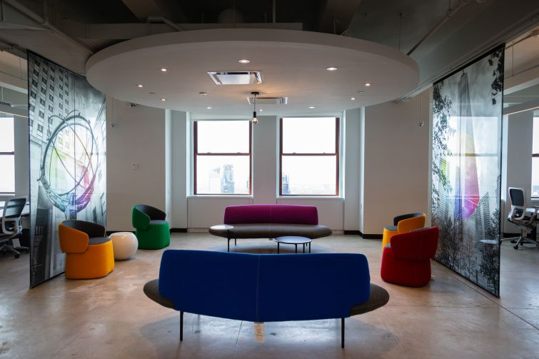 Relaxed seating can be found all over the office, as well as images of popular New York City places.