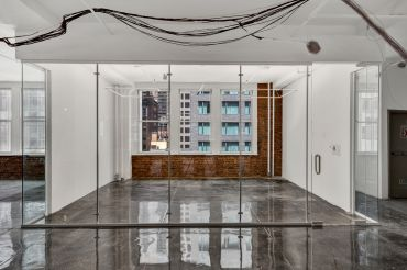 Zar Property has renovated the office spaces with exposed brick walls, polished concrete floors and glass partitions.