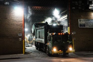 A commercial trash truck leaves a waste transfer station in Bushwick.