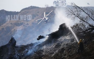 Firefighters including a helicopter work the Griffith fire.