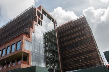 Floor-to-ceiling glass goes in on the western wall of 25 Kent.
