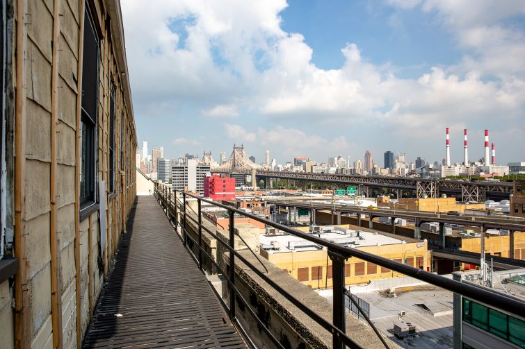 Normandy Real Estate Partners is converting a warehouse at 43-10 23rd Street  into creative office space. The future roof deck has views of the Queensboro Bridge, looking out over Long Island City's industrial zone.