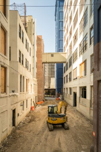 The alleyways between the buildings at 'The Hall' will eventually become landscaped common areas with seating and space for events.