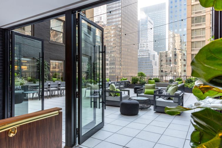 Office tenants at 10 Grand Central will be able to enjoy a new outdoor terrace on the seventh floor with plantings, seating, a fire pit, a bar cart and and possibly catering from a downstairs restaurant.