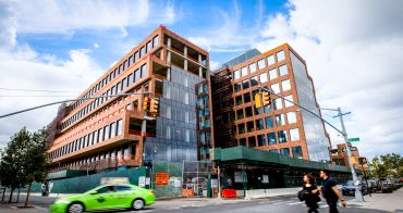 Heritage and Rubenstein Partners recently completed work on an office and industrial building at 25 Kent, pictured here while it was under construction last year.
