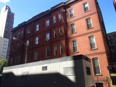 The current four-story property at 323 East 61st Street.