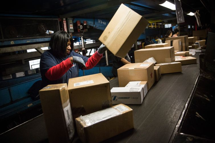 A woman works in a Fedex warehouse in Newark, N.J.