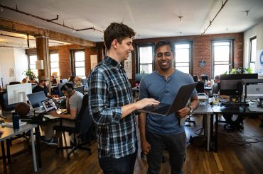Meridio co-founders Corbin Page (left) and Mohammad Shaikh, at the company's New York's offices, are working to put shared building ownership on the blockchain. Shaikh said it will allow users to easily transfer shares without mountains of paperwork.