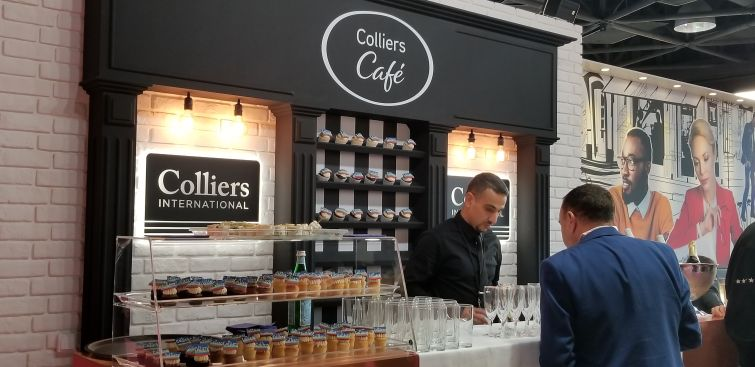 Colliers International serving up baked goods and champagne on the floor of MAPIC.