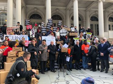 City Councilman Jimmy Van Bramer, Comptroller Scott Stringer, members of the Retail, Wholesale and Department Store Union and other opponents rally against the Amazon deal before a City Council oversight hearing on it.
