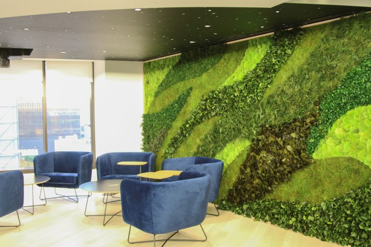 A break room at EY's revamped offices in downtown Los Angeles brings some of the outside in with textured materials.